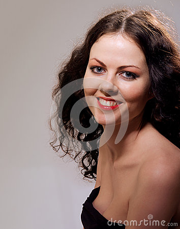 Smiling girl with naked shoulders