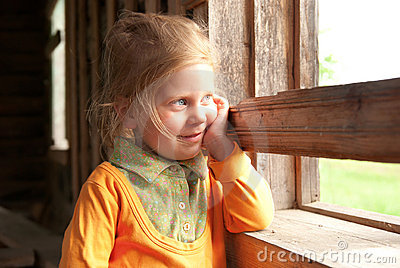 Smiling girl near the window