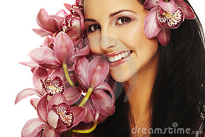 Smiling girl with nice flower