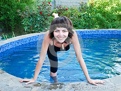Smiling girl in the outdoor pool