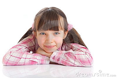 Smiling girl in pigtails