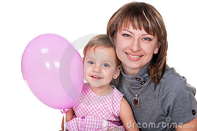 Smiling girl in pink and her mom
