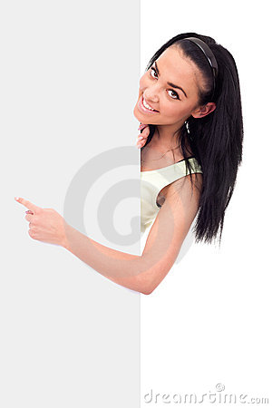 Smiling girl pointing at a blank board