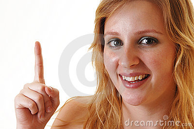 Smiling girl pointing finger.