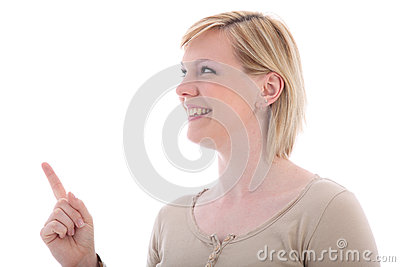 Smiling girl pointing to copyspace