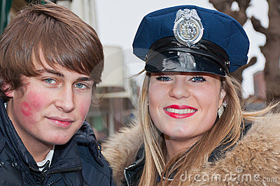Smiling girl with police cap and her boyfriend. Editorial Stock Image