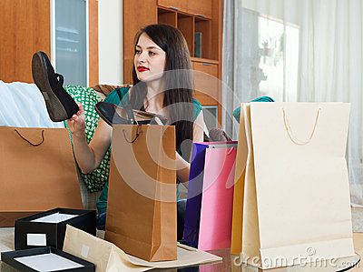 Smiling girl with  purchases