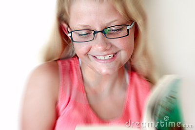 Smiling girl reading book