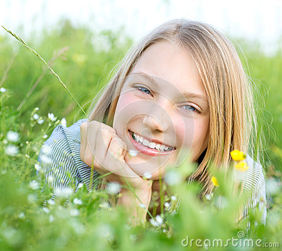 Smiling Girl Relaxing outdoors