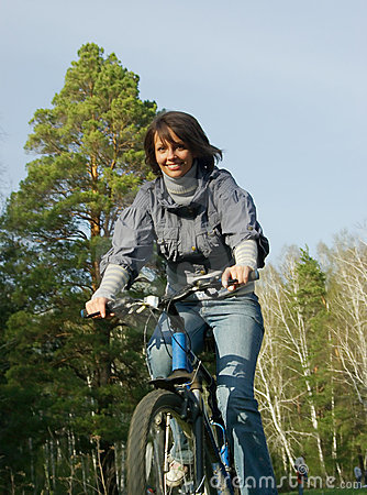 Smiling girl riding on bicycle