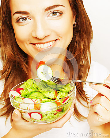 Smiling girl with a salad