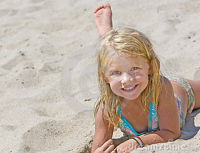 Smiling Girl on Sand