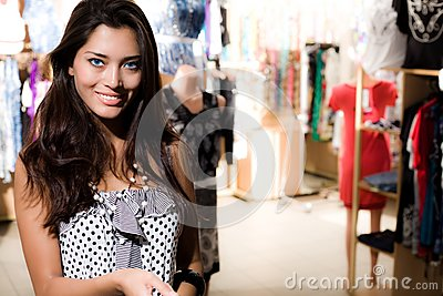 Smiling girl is shopping