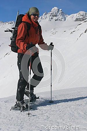 Smiling girl on snowshoe trip