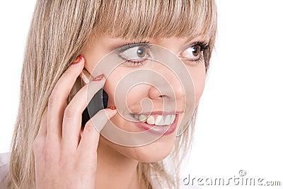 Smiling girl speaks on the mobile phone