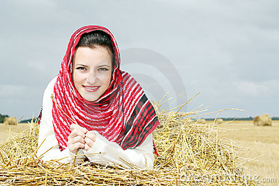 Smiling girl on a stack of straw