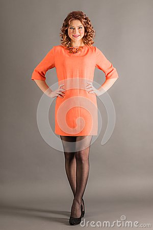 Free Smiling Girl Standing In Studio On Gray Background Royalty Free Stock Images - 113092429