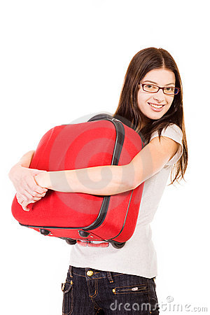 Smiling girl with suitcase on a white background