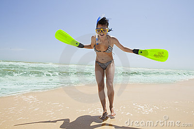 Smiling girl in swimming mask and fins