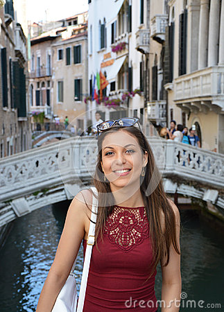 Free Smiling Girl Tourist Standing Above Traditional Bridge On Canals In Venice. Beautiful Woman Model Traveling In Venice, Italy Royalty Free Stock Photos - 96560378
