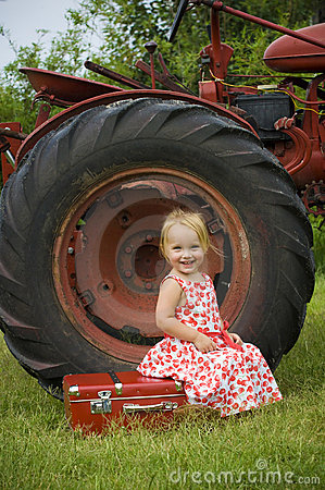 Smiling girl and tractor