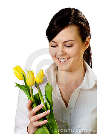 Smiling girl with tulips