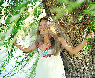 Smiling girl under willow tree