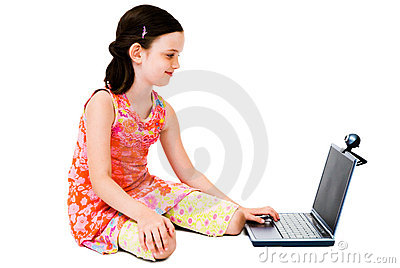 Smiling girl using a laptop