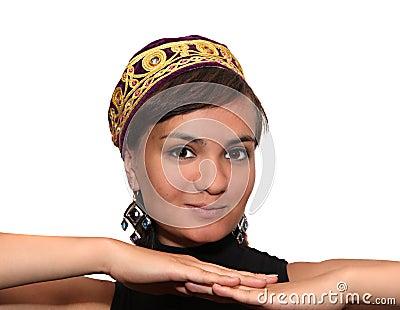 Smiling girl in violet skullcap