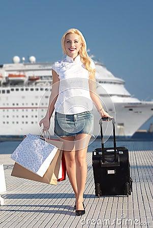 Smiling girl walking on pier
