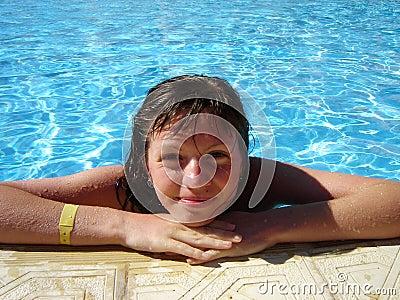 Smiling girl water-pool