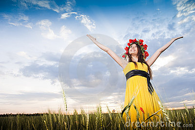 Smiling girl in the wheat field
