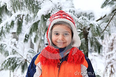 Smiling girl in the winter park
