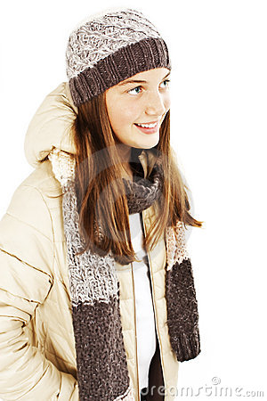 Smiling girl in winter style, looking up.
