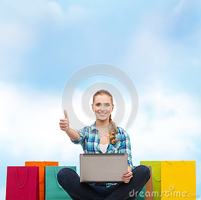 Free Smiling Girl With Laptop Comuter And Shopping Bags Royalty Free Stock Image - 39809616
