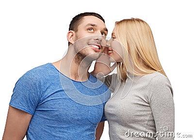 Smiling girlfriend telling boyfriend secret