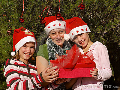 Smiling girls  with Christmas gift