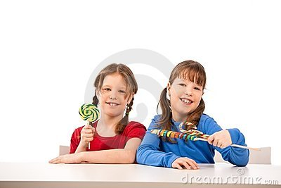 Smiling girls with lollipops