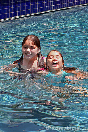Smiling girls in swimming pool