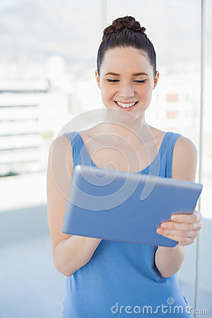 Smiling gorgeous woman using tablet pc