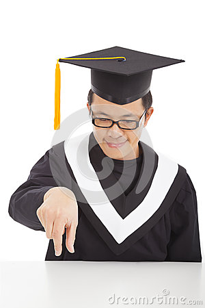 Smiling  graduating student focus his fingers to catch