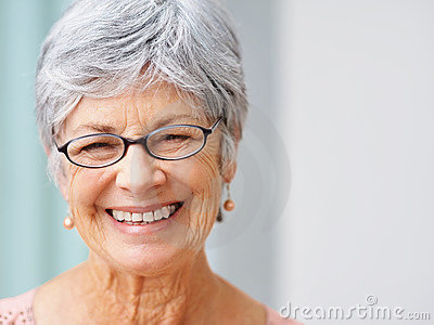 Smiling gray haired woman with copyspace