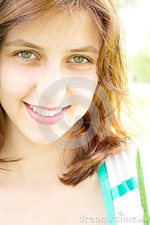 Smiling green-eyed girl