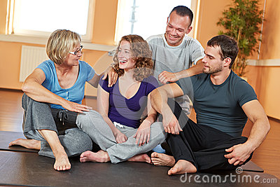 Smiling group talking in fitness