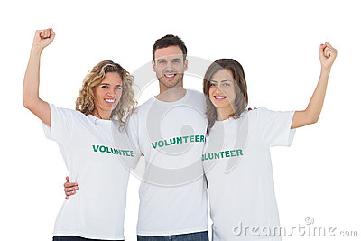 Smiling group of volunteers raising arms