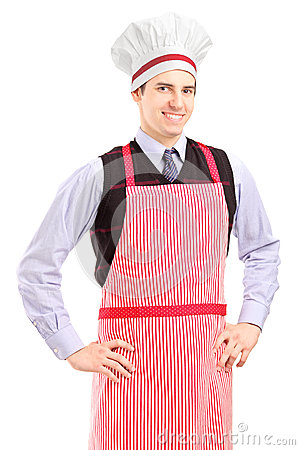 A smiling guy with cooking hat and apron posing