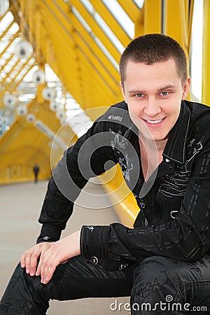 Smiling guy  on footbridge