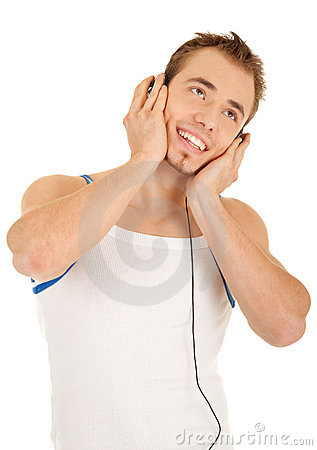 Smiling handsome man is listening music