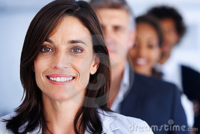 Smiling happy business woman looking at the camera