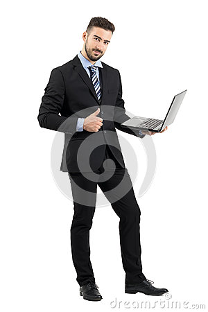 Free Smiling Happy Businessman With Laptop Showing Thumb Up Gesture Looking At Camera Royalty Free Stock Photography - 61952917